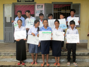 Local school children and the posters they made to promote Ibis conservation